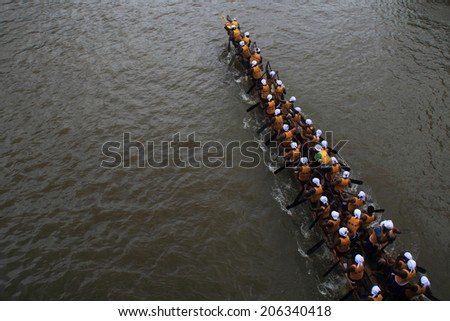 PAYIPPAD, INDIA - SEPT 18: A snake boat team participate in the Payippad Boat race on September 18, 2013 in Payippad, Kerala, India. Boat races are the major sporting events in Kerala. - stock photo