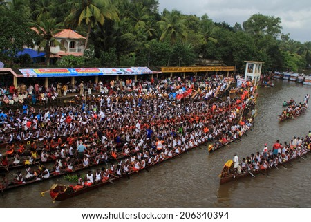 PAYIPPAD, INDIA - SEPT 18:Snake boat teams line up to participate in the Payippad Boat race on September 18, 2013 in Payippad, Kerala, India. Boat races are the major sporting events in Kerala. - stock photo