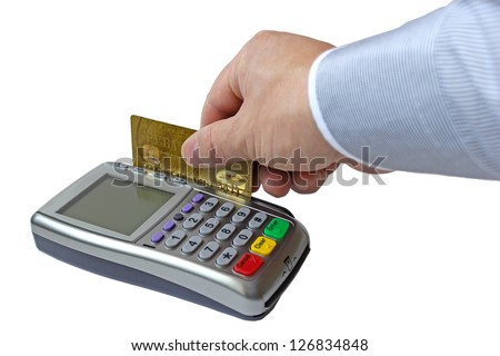 Payment for the goods by credit card through the payment terminal - stock photo
