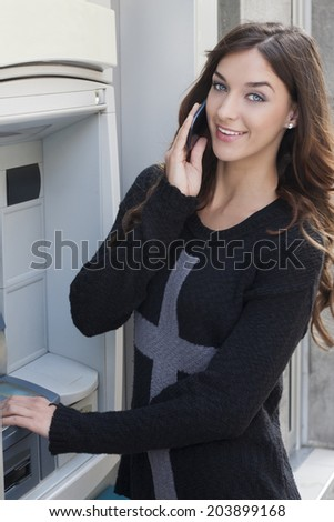 payment of money and talking with the mobile phone - stock photo
