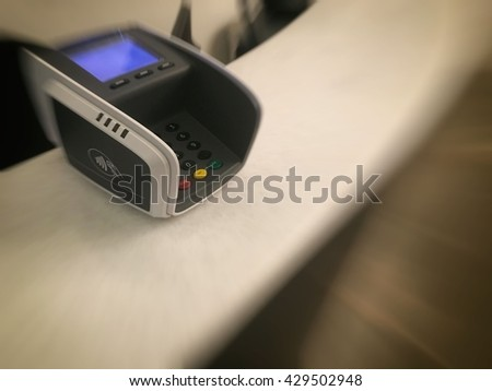 Payment terminal at hotel reception