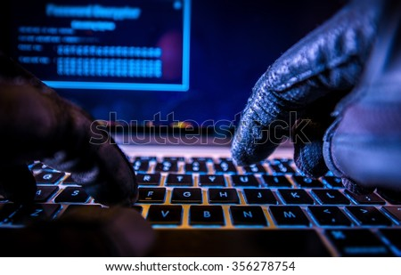 Payments System Hacking. Online Credit Cards Payment Security Concept. Hacker in Black Gloves Hacking the System. - stock photo