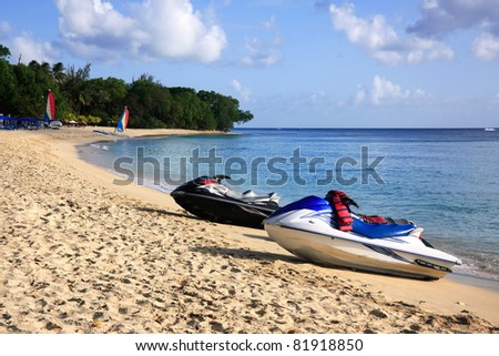 Paynes Bay beach in Barbados with jet skis in the foreground - stock photo