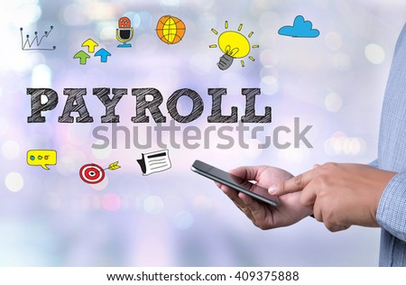 PAYROLL person holding a smartphone on blurred cityscape background - stock photo