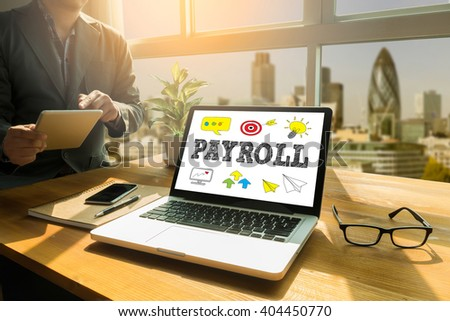 PAYROLL Thoughtful male person looking to the digital tablet screen, laptop screen,Silhouette and filter sun - stock photo