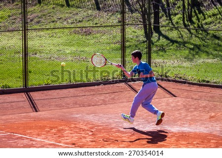 PAZARDZHIK, BULGARIA - APRIL 04, 2015 - Tennis tournament for children till 14 years of age - 04 April 2015. The competition was held on Pazardzhik tennis club courts.