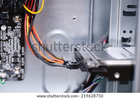 PC from inside with wires connected to HDD. Closeup with shallow DOF. - stock photo