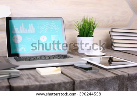 PC laptop, tablet and phone on wooden table
