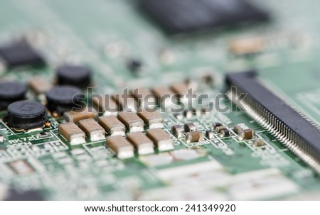 PCB macro shot with a lot of electrical components - stock photo