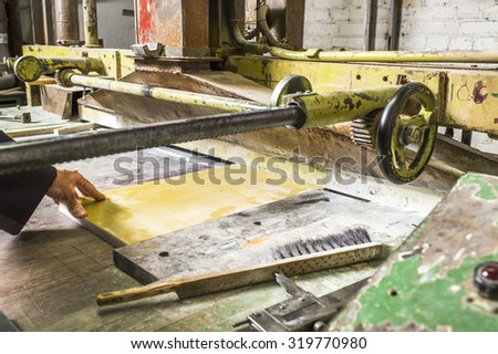 PCB plate on the machine Slitter - stock photo