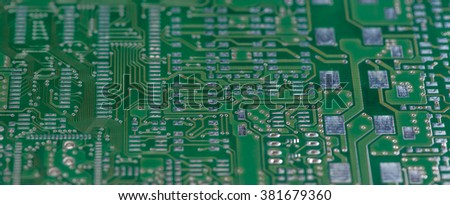 PCB with different electronic circuits (close-up shot) - stock photo