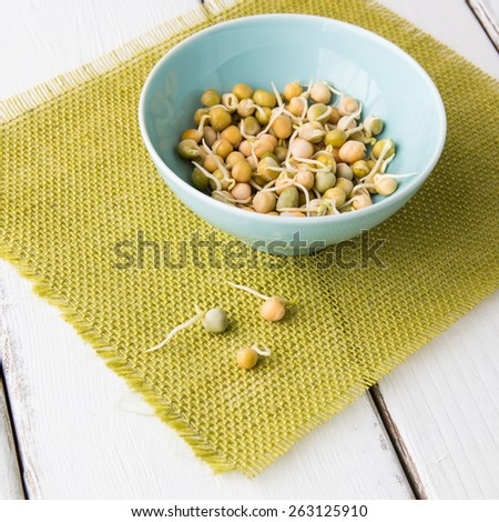 Pea seeds with sprouts in a bowl. - stock photo