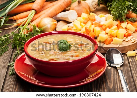 Pea soup with bacon and sausage in a bowl - stock photo
