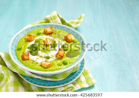 Pea soup with mint and fried bread chips