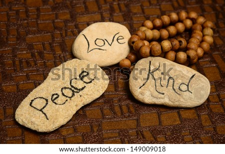 peace, love and kindness words on rocks for world peace - stock photo