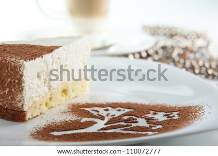 Peace of cake on white dish and white background