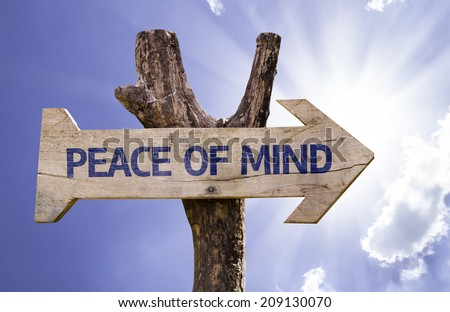 Peace of Mind wooden sign on a beautiful day - stock photo
