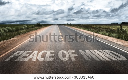 Peace of Mind written on rural road - stock photo