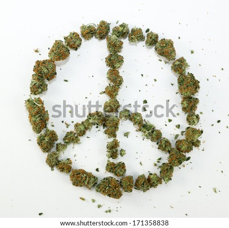 Peace Sign Made of Marijuana. A peace sign symbol made with real marijuana on white. - stock photo