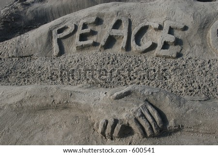 Peace spelled out in the sand. - stock photo