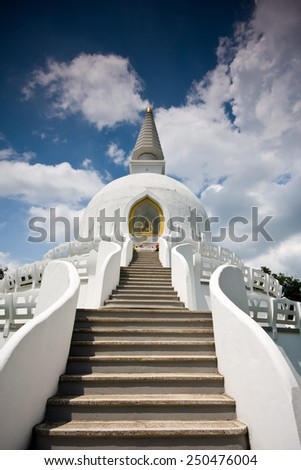 peace stupe with blue sky - stock photo