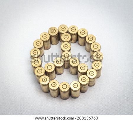 peace symbol formed by bullets over white background, useful for peace,war,terrorism,military and similar themes - stock photo