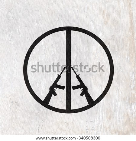 peace symbol with rifles on wood grain texture - stock photo