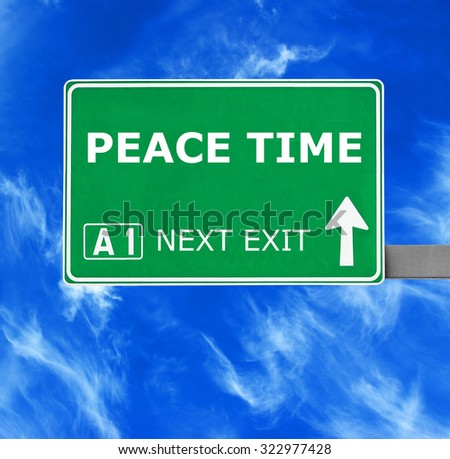PEACE TIME road sign against clear blue sky - stock photo