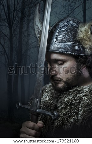 Peace, Viking warrior, male dressed in Barbarian style with sword, bearded - stock photo