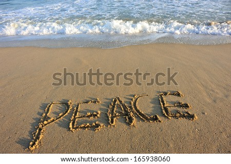 peace word drawn on the beach  - stock photo