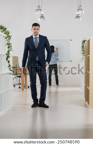 Peaceful asian caucasian businessman in office full length portrait - stock photo