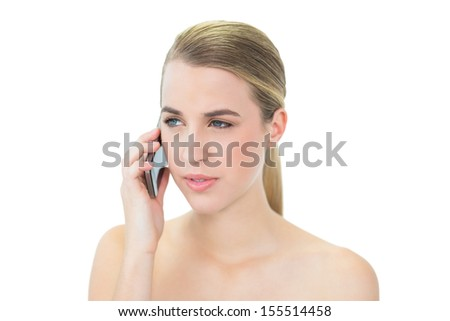 Peaceful attractive blonde on white background on the phone - stock photo