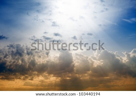 Peaceful background - sunset sky, bright sun shines through clouds - stock photo