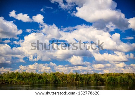 Peaceful Biebrza river seen from the sailor perspective - stock photo