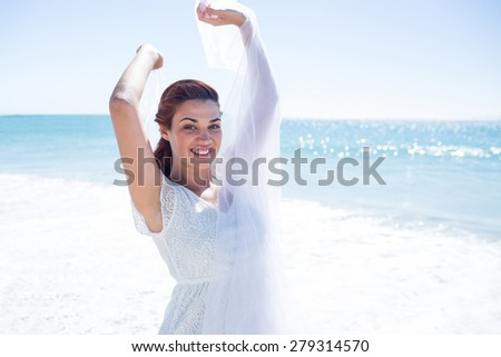 Peaceful brunette enjoying the air at the beach - stock photo