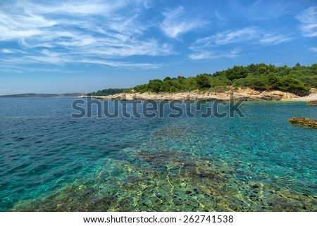 Peaceful calm Coastline with horizon and sky  - stock photo