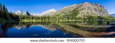 Peaceful calm reflections on lake Josephine in Glacier National Park