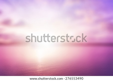 Peaceful concept: Abstract blur beautiful purple ocean with pink sky sunset background.