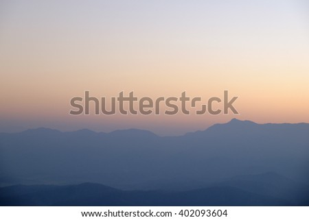 peaceful early morning foggy mountains landscape - stock photo
