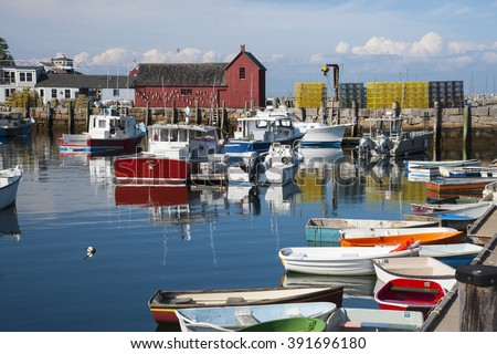 Peaceful early summer evening at Rockport Harbor in Massachusetts. The harbor, with its red fishing shack called ?Motif Number 1, is the most often painted harbor in America. - stock photo