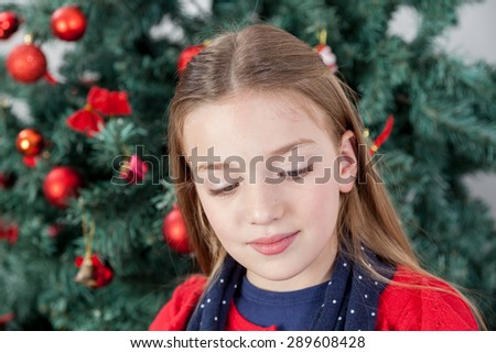 Peaceful girl in front of the tree christmas - stock photo