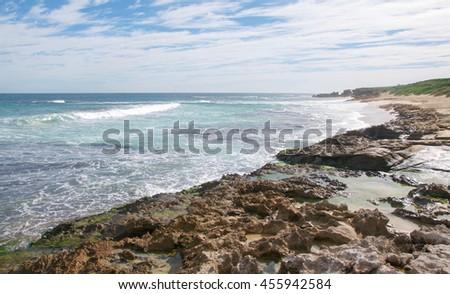 Peaceful Indian Ocean seascape and coastal limestone at Penguin Island in Rockingham, Western Australia/Peaceful Seascape: Penguin Island/Rockingham, Western Australia - stock photo