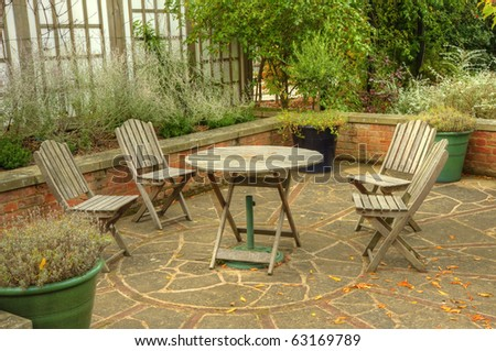 Peaceful inviting image of English country garden with furniture and vibrant Autumn Fall colors