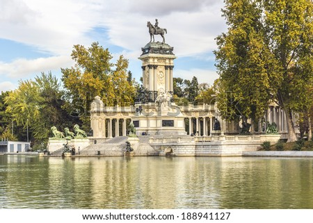 Peaceful lake and Monument to King Alfonso XII (designer Jose Grases Riera, 1922) in Parque del Buen Retiro. Buen Retiro Park - one of largest parks of Madrid City. Spain.