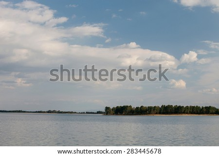 Peaceful lake at the foot of the Sierra de Gredos within Spain - stock photo