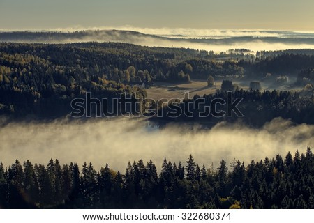 Peaceful landscape of Aulanko nature reserve park in Finland. Thick fog covering the scenery in the early morning. HDR image. - stock photo