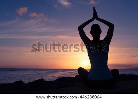 Peaceful meditation. Woman doing yoga by the sea.  - stock photo
