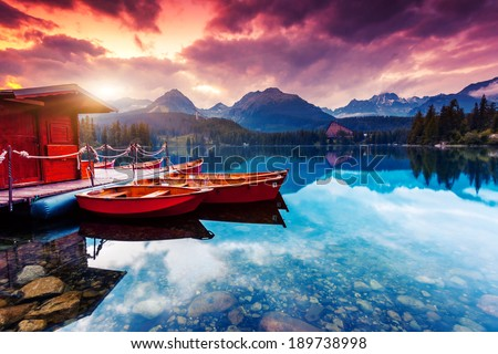 Peaceful mountain lake in National Park High Tatra. Dramatic overcast sky. Strbske pleso, Slovakia, Europe. Beauty world. - stock photo