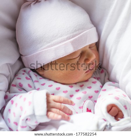 Peaceful newborn baby sleeping three days old.
