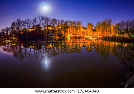 peaceful night view over the lake with moon